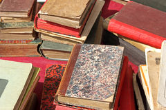 Piles of old books. Piles of old damaged books on a table Royalty Free Stock Images
