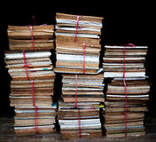 Piles of the old books. On black background Royalty Free Stock Image