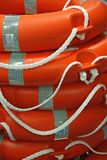 Piles of Orange life preserver for help to people in danger of d Royalty Free Stock Photo