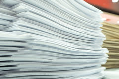 Piles of paper on my desk at work. Piles of paper on my desk at work station Royalty Free Stock Photo