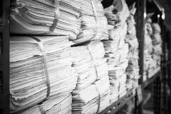 Piles of paper on the shelves. Backgrounds Stock Photo