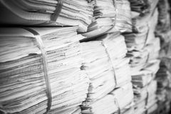 Piles of paper on the shelves. Backgrounds Royalty Free Stock Photography