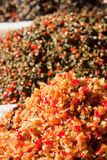 Piles of pickled asian vegetables. Piles of picled asian vegetables on display in market Royalty Free Stock Photos
