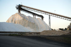 Piles of pure vacuum salt with elevator construction. In Dominion Salt, Mt Maunganui, Tauranga, New Zealand Stock Images