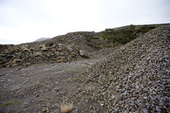 Piles of rock in quarry Stock Photography