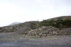 Piles of rocks in small quarry Royalty Free Stock Image