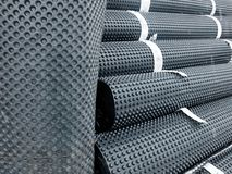 Piles of rolled membrane. Waterproofing tied with tape stock photo