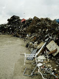 Piles of rubbish in scrapyard Stock Images