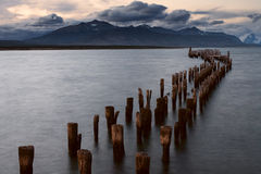 Piles of ruined pier into the sea. Stock Images