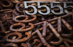 Piles of rusty metal numbers and letters. Numbers and letters, rusty metal royalty free stock photo