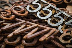 Piles of rusty metal numbers and letters. Numbers and letters, rusty metal royalty free stock images