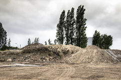 Piles of sand and dirt at construction works Stock Images