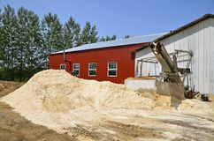 Piles of sawdust outside a wood manufacturing plant Stock Photo