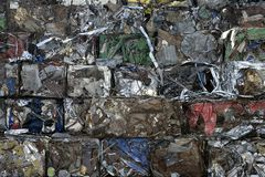 Piles of scrap metal bundled in bales. For recycling stock images