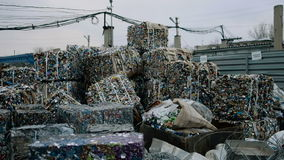 Piles Of Scrap Metal Bundled in Bales for Recycling stock footage