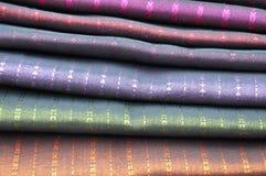 Piles of silk pashmina scarves stock photo