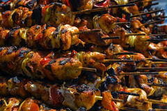 Traditional romanian food (1). Piles of skewers stacked to be served Royalty Free Stock Images