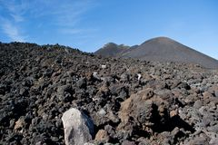 Piles of sloped black lava under the Etna volcano. In Sicily Royalty Free Stock Photos