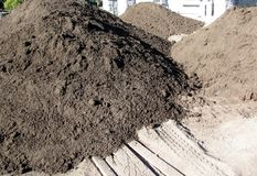 Piles of soil for landscaping Stock Images