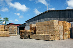 Piles of stacked rough cut lumber at a sawmill Stock Images