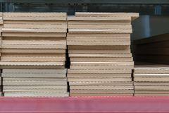 Piles or stacks of paper boxes with goods in storage. Stock Images