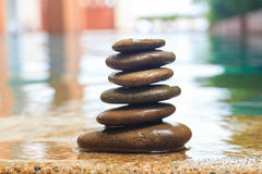 Piles of stones in swimming pool Stock Image