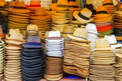 Piles of straw hats on display at Camden Market in London stock image
