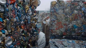 Piles of Tin Cans in Compressed Blocks stock footage