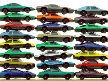 Piles of Toy Cars. A collection of small, cheap toy cars - arranged in a stack and isolated over pure white Stock Photography