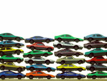 Piles of Toy Cars. A collection of small, cheap toy cars - arranged in a stack and isolated over pure white Royalty Free Stock Photo