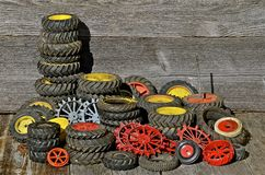 Piles of Toy Tractor Tires and Rims Stock Photos