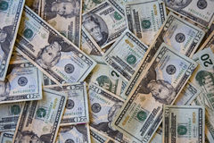 Piles of twenty dollar bills Stock Photo