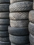 Old and worn tires. Piles of used and worn car tires Royalty Free Stock Photos