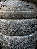 Old and worn tires. Piles of used and worn car tires Royalty Free Stock Photography
