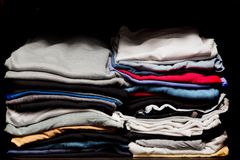PIles of various clothes from laundry in a wardrobe Royalty Free Stock Images