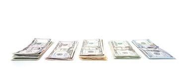 Piles of various dollar notes Royalty Free Stock Image