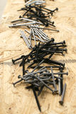 Piles of various nails and screws for woodworking Stock Photography