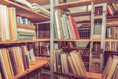 Piles of vintage books on a shelf Royalty Free Stock Photos