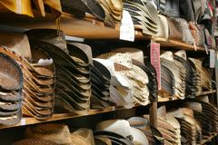 Piles of western american hats in rows royalty free stock photo