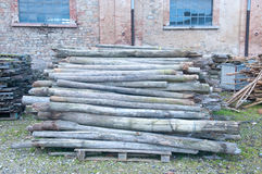 Piles of wood outside in a parking lot Royalty Free Stock Photography