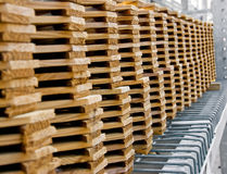 Piles of wood panels on metal shelf Royalty Free Stock Photography