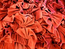 Red fabric. Piles of wrinkled red fabric Stock Photo