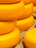 Piles of yellow Dutch cheese on a market Royalty Free Stock Image