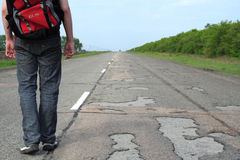 Pilgrim. Man goes on road in the summer Stock Photos