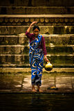 A Pilgrim bathes and wash in the holy waters of the Ganges, Varana Stock Photography