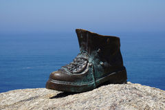 Pilgrim boot on Cape Finisterre Stock Photos