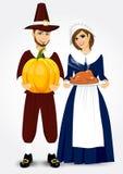 Pilgrim couple holding a roast turkey and pumpkin Stock Photography