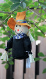 Pilgrim doll. Thanksgiving pilgrim doll hanging from tree. home decor. outdoors royalty free stock images