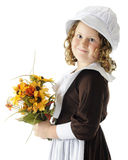 Pilgrim Flower Girl. A young elemantary Pilgrim with a bouquet of colorful flowers.  On a white background Stock Photography