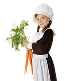Pilgrim Girl with Carrots Royalty Free Stock Photos